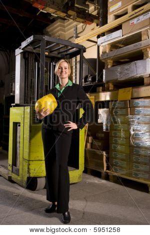 Female businesswoman standing in storage warehouse
