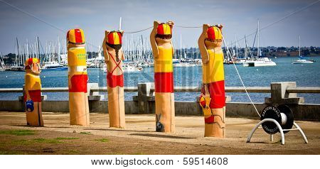 GEELONG, AUSTRALIA - JANUARY 31: Colourful bollards on Geelong's foreshore. More than 100 by artist Jan Mitchell line the waterfront and are an important icon of Geelong - January 31, 2014 in Geelong, Australia