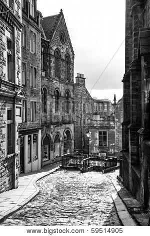 Edinburgh cobbled street in black and white