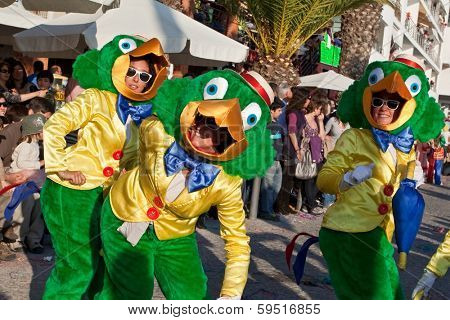 Sesimbra, Portugal - February 12, 2013: Performers dressed as the Brazilian Disney character Jose Carioca parading the Brazilian Carnival on Feb/12/2013 in Sesimbra, Portugal