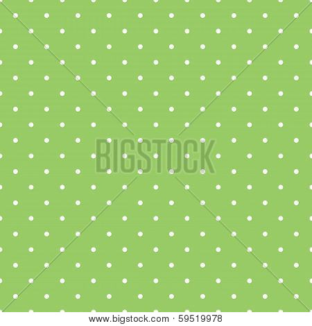 Seamless spring vector pattern with white polka dots on fresh grass green background.