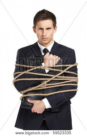 Portrait of businessman handing briefcase who tied with the line, isolated on white. Concept of slavery and violence