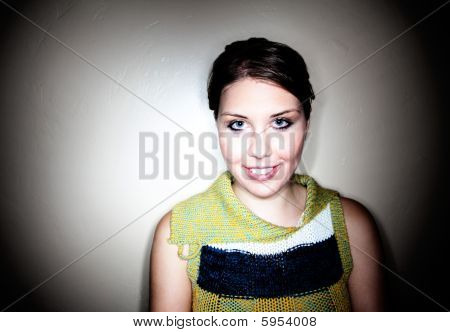 Cute young girl captured in a circlular spotlight poster