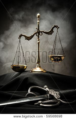 Scales and sword of Justice on a judge's mantle
