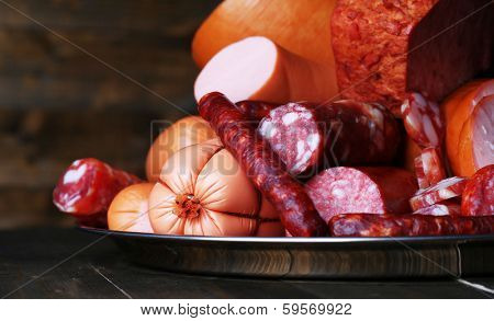 Lot of different sausages on salver close-up