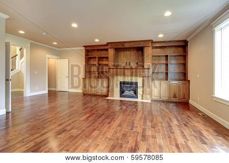Brigh Living Room With Fireplace And Storage Combination