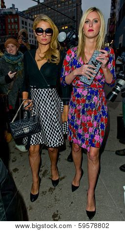NEW YORK-FEB 9: Paris Hilton and Nicky Hilton (R) arrive at the Diane von Furstenberg fashion show during Mercedes-Benz Fashion Week at Spring Studios on February 9, 2014 in New York City.