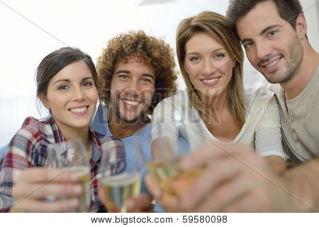 Closeup of friends cheering with glass of wine poster