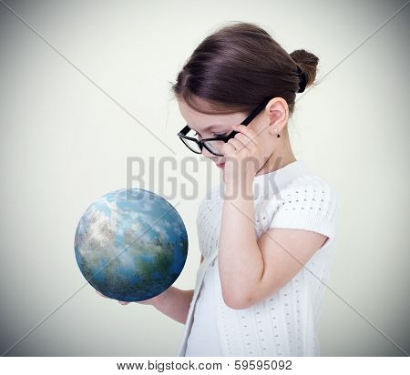 Girl holding the Planet Earth.