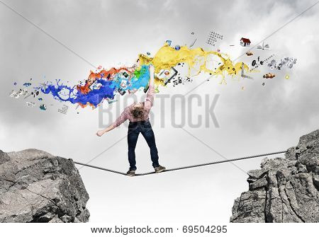 Young man in casual evading from flying icons poster