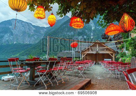 Lampions in empty restaurant of Hallstatt town, Austria poster