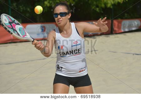 MOSCOW, RUSSIA - JULY 18, 2014: Marie-Eve Hoarau of France in the match against Italy during ITF Beach Tennis World Team Championship. Italy won 2-0