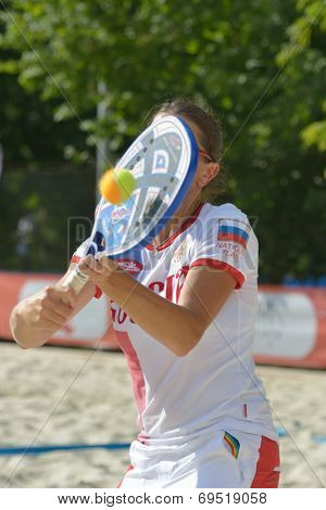 MOSCOW, RUSSIA - JULY 17, 2014: Lyudmila Nikoyan of Russia on the training during the ITF Beach Tennis World Team Championship. Russia hosts the championship for the third time
