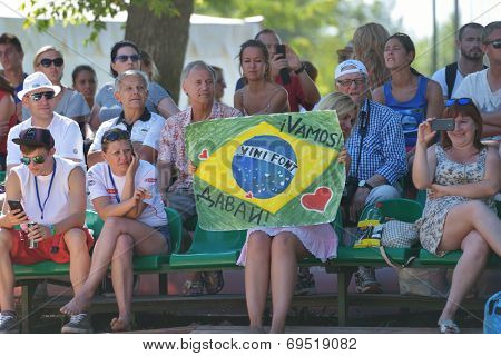 MOSCOW, RUSSIA - JULY 20, 2014: Fans support the men's double of Brazil and personally Vinicius Font in the final match during ITF Beach Tennis World Team Championship. Italy won in two sets