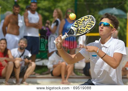 MOSCOW, RUSSIA - JULY 18, 2014: Nicolo Bombini of San Marino in the match against Spain during ITF Beach Tennis World Team Championship. Spain won 2-1