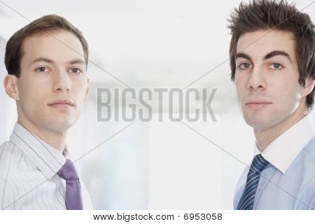 Handsome Young Businessmen Facing Camera