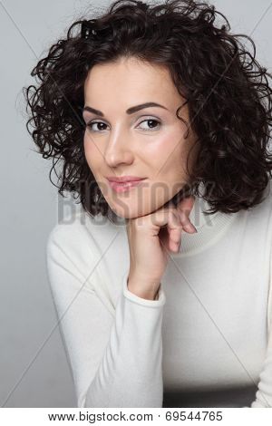 Young attractive woman with curly hair in casual outfit