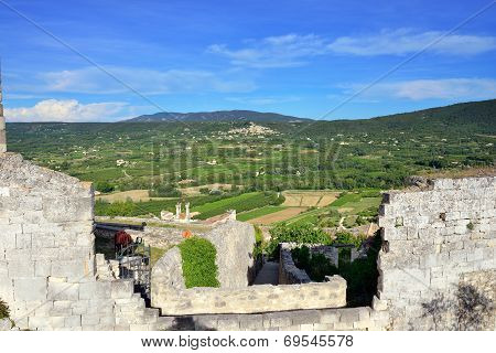 Provence rural landscape. View on the beautiful medieval village Bonnieux from ruins of marquise de Sade castle in village Lacoste. France poster