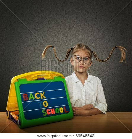 Funny little girl with braided hair up big glasses beside her plate Back to School subtitles poster