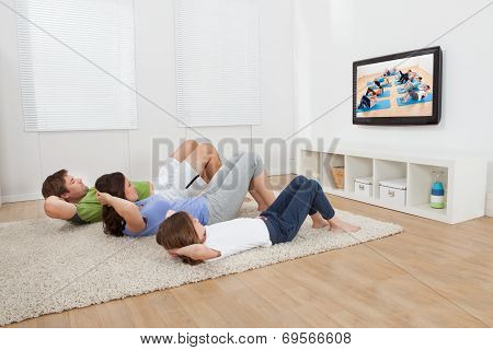 Family Doing Situps While Watching Tv