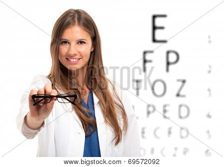 Smiling female oculist holding a pair of eyeglasses