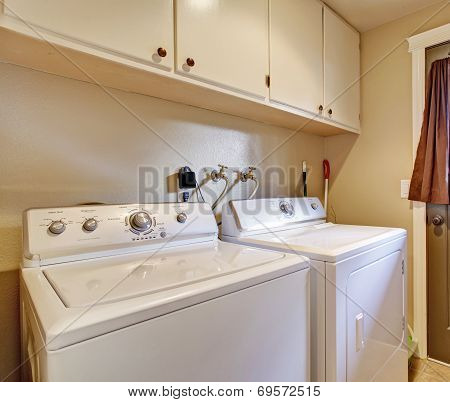 Laundry Room With Exit To Backyard