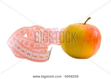Pink Measuring Tape And Apple