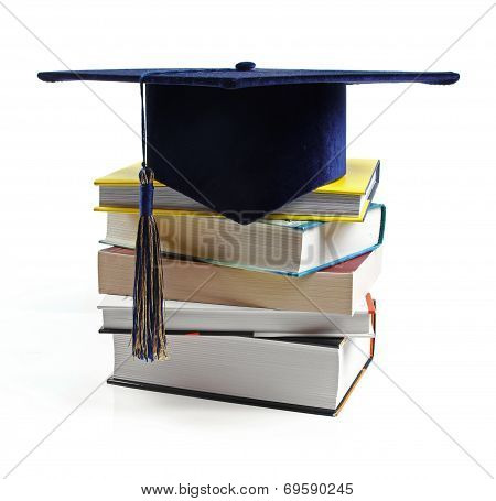 Graduation Hat And Stack Of Books Isolated On White