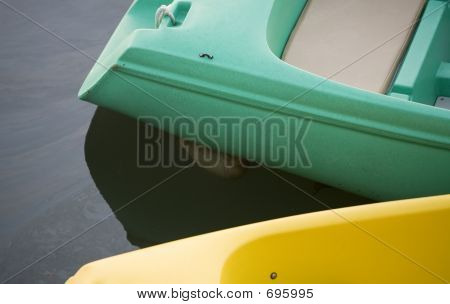 Stock Photo Of A Green And Yellow Paddle Boat