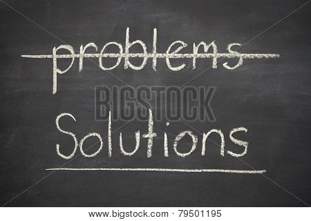 Problems Crossed Out And Solutions Written Underneath On A Blackboard