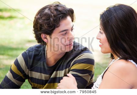 Attractive Hispanic Couple At The Park