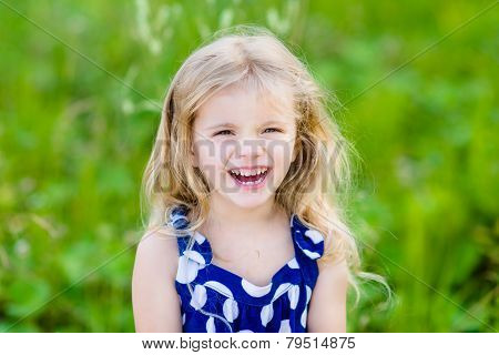 Pretty Laughing Little Girl With Long Blond Curly Hair, Outdoor Portrait In Summer Park