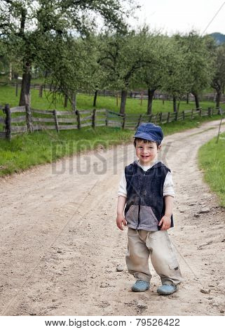 Child Standing On A Country Road