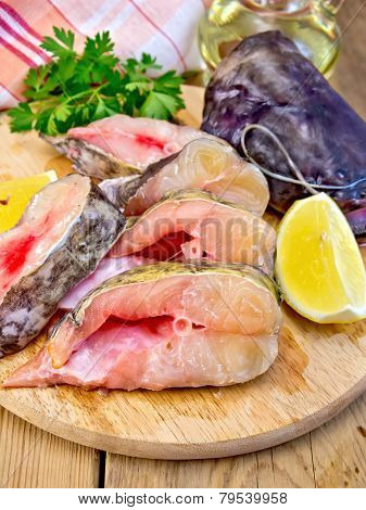 Catfish raw with lemon on board