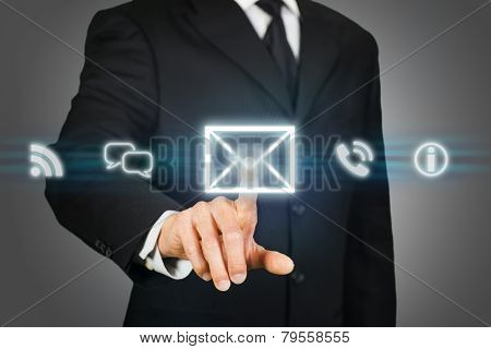 Businessman clicking on email icon on a virtual touchscreen poster