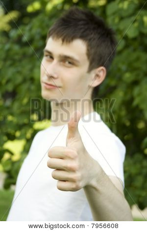 Teenager sign thumbs up