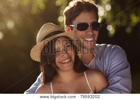 Young Couple Together Outside In Summer