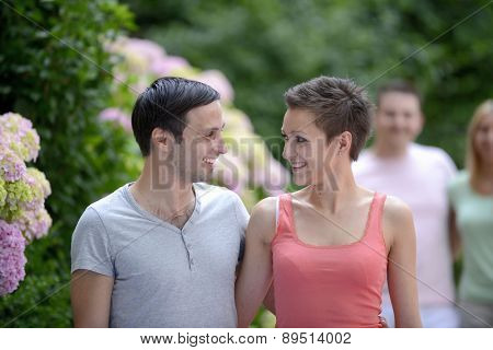 Portrait of a happy young heterosexual couple flirting