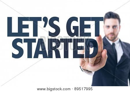 Business man pointing the text: Lets Get Started