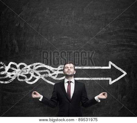 Meditative Young Businessman Is Trying To Find The Best Solution For Business Development. An Arrow