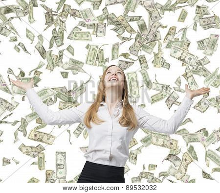 Beautiful Blonde Business Woman Is Happy About Flying Dollar Notes. Isolated On White Background.