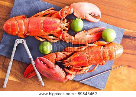 Cooked Lobsters On Table With Lime And Tool