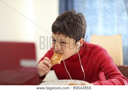 Young boy eating breakfast toast