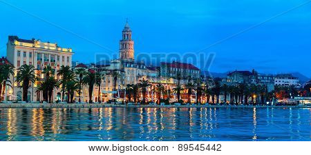 View of Split is the second-largest city of Croatia at night. Shore of the Adriatic Sea and famous Palace of the Emperor Diocletian - archaeological gem and a must-see for everyone poster