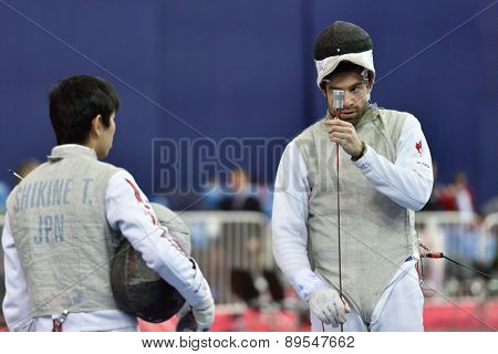 ST. PETERSBURG, RUSSIA - MAY 1, 2015: Etienne Lalonde Turbide of Canada vs Takahiro Shikine of Japan in International fencing tournament St. Petersburg Foil. The tournament is the stage of World Cup