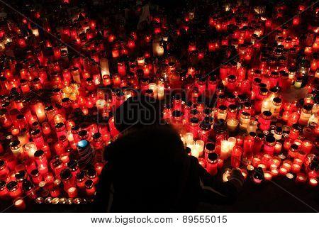 PRAGUE, CZECH REPUBLIC - DECEMBER 22, 2011: People light candles in memoriam late Czech president Vaclav Havel in Wenceslas square in Prague, Czech Republic.