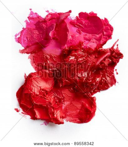 Smudged lipsticks isolated on the white background poster