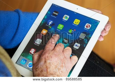 Senior Woman Using Tablet With Many App On A Ipad Screen