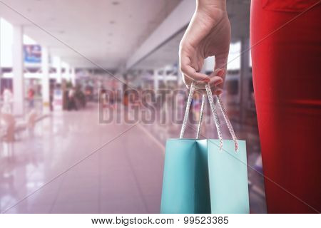 Woman with two shooping bags