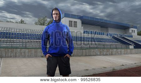 Athlete man posing over grunge stadium. Wide HDR shot. Composing retouching poster